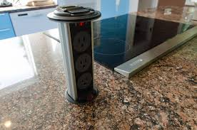 concrete countertops pop up electrical outlets for kitchen islands