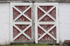 Red Door Paint Rustic Old Red And White Barn Doors With Peeling Paint Stock Photo