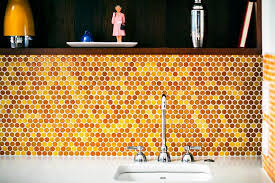 kitchen orange backsplash of penny tiles in tones of yellow