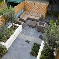 small contemporary designed garden in putney with rendered raised