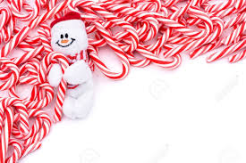 mini candy canes making a border on a white background candy