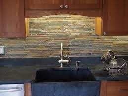 Chosing A Backsplash With Black Granite Counters - Granite tile backsplash ideas