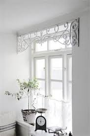 kitchen window dressing ideas metal window frieze dresses up the window without blocking the