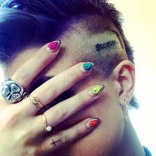 demi lovato tattoo cross celebrities reveal their tattoos photos abc news