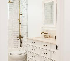Shower Kit With Bathtub Shower Subway Tiles With Dark Grout And Brass Exposed Plumbing