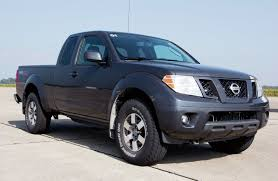 blue nissan truck behind the wheel of the diesel nissan titan and frontier photo