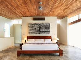 bedroom i like the concrete floors central bed with wall behind