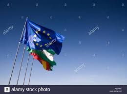 european union flag andalucian flag and the spanish flag fly from