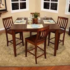 traditional dining room with 5 piece brown high top kitchen table