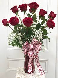 one dozen roses you this much one dozen stemmed roses by petals vased