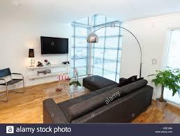 Simple Black Sofa Set View Of Floor Lamp Over Black Sofa Set With Flat Screen Tv At
