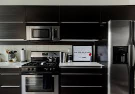 black kitchen cabinets with black hardware black kitchen cabinets apartment therapy