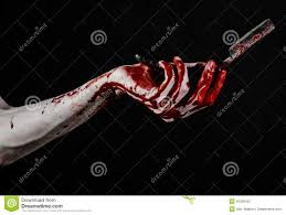 halloween theme background bloody halloween theme bloody hand holds a razor sharp old with a