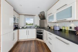 red and white kitchen designs kitchen beige quartz countertops red tile backsplash copper