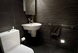 marvelous black and white bathroom tiles in a small bathroom in