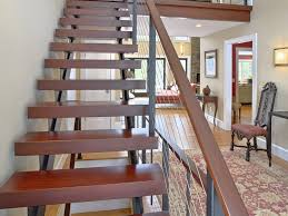 double stringer floating staircase with cable railing and wood