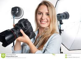 Professional Photographer Professional Photographer Working In Studio Stock Photo