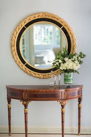 luxurious interior with elegant inlaid adams style console and