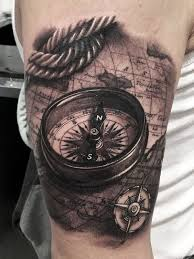 picture of artistically rich 3d compass and world map tattoo