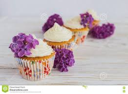 homemade sweet cupcake with cream and flowers stock photo image