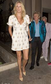penny lancaster shows cleavage out with husband rod stewart for