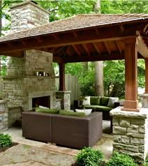 stone fireplace and wicker sofa for traditional gazebo ideas
