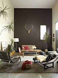 living room accent wall with brown furniture chrome end table