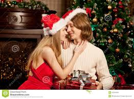 nice young love couple near the christmas tree woman and man ce