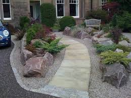 simple rock garden with decorative flower bed driveway with