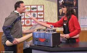 sandra bullock serves ice cream with fake arms on the tonight show