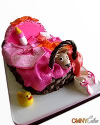 pink and orange bassinet baby shower cake cmny cakes