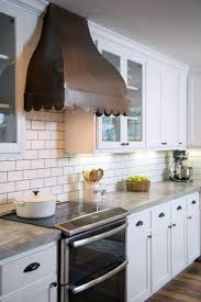 copper backsplash tiles kitchen surfaces pinterest copper vent hood concrete countertop white wooden kitchen base