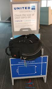 united checked bag what is the united and american airlines carryon bag check real size