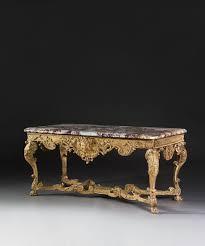arcade en bois console d u0027époque régence en bois sculpté et doré dessus de marbre
