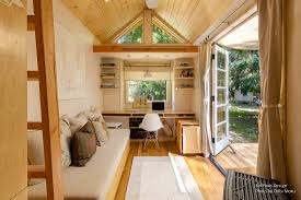 tiny home 2 story woman living simply in off grid tiny home on wheels