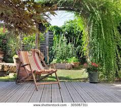 terrace gardening lounge chair on wooden terrace garden stock photo 305067311