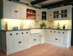 cream wooden cabinet and kitchen island with brown counter top