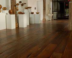 our reclaimed tobacco pine flooring offers a rich patina