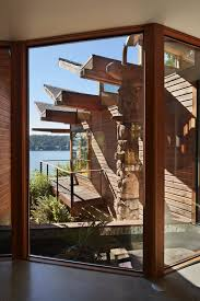 a maury island home elegantly changes its perspective thanks to a swain used three types of windows in the frosts home most of the