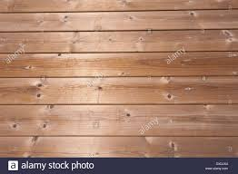 overlapping softwood pine larch slats of wood with sheen from