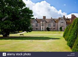 lawn and garden of an english tudor country manor in berkshire
