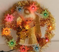 a kitschy vintage light up tree topper