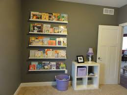 Bookshelves Decorating Ideas White Wooden Wall Shelves On Grey Wall Connected By Small Purple
