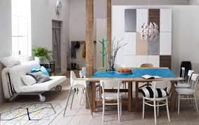 ikea dining room ideas two ikea dining tables pushed together surrounded by chairs and a