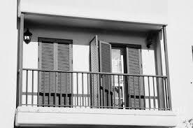 modern pvc sun shutter blinds on balcony doors and windows of