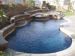 awesome backyard pool landscaping design with natural wall brown