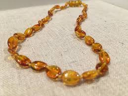 amber necklace images Polished honey bean 11 pop baltic amber necklace teething fever colic jpg