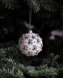 white and gray baubles hanged on green tree free image