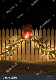 Christmas Fence Decorations White Picket Fence Christmas Decorations Stock Photo 7970059