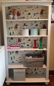 upcycled pine shelves painted and back board in cath kidston